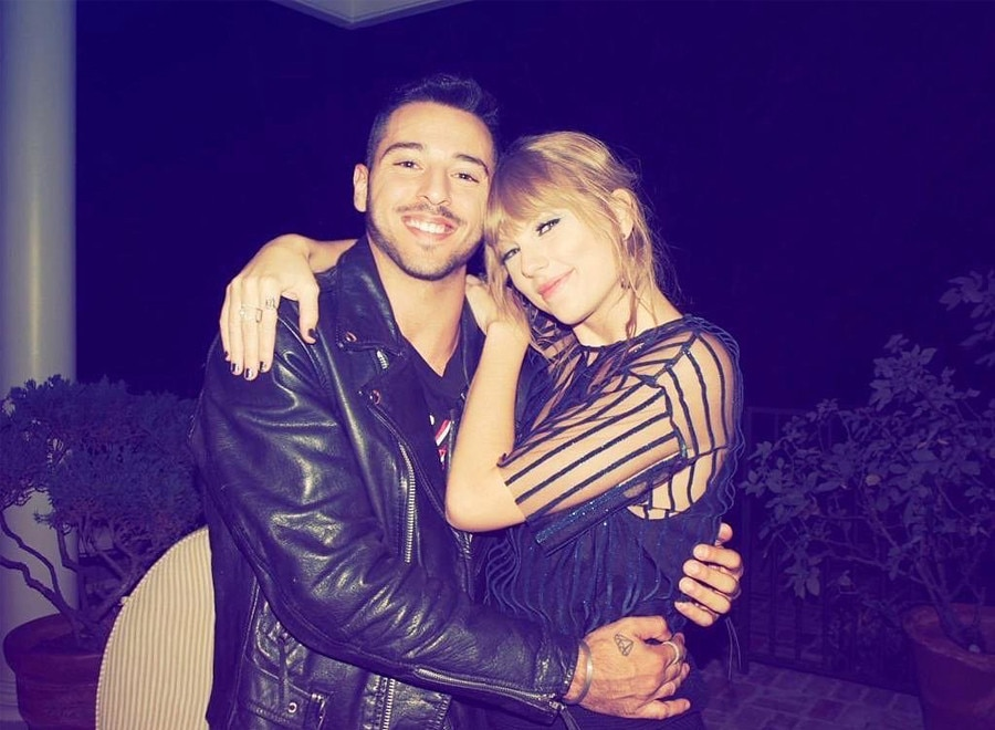 Friends 4 Eva -  Taylor and a backup dancer pose together for a sweet photo opp.