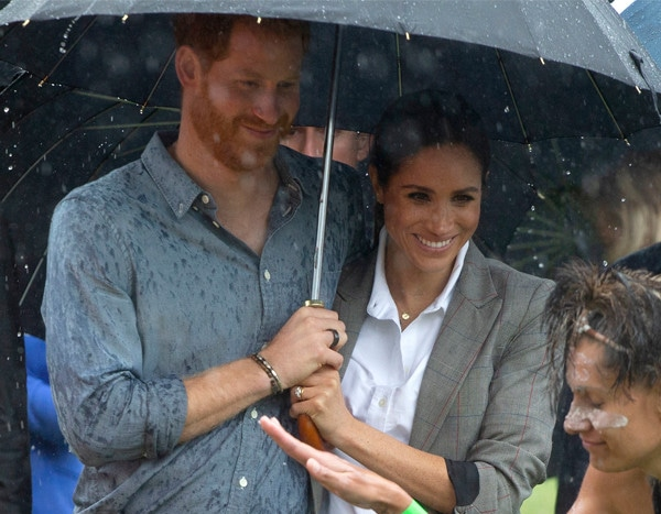 Meghan Markle Sweetly Holds Prince Harry's Umbrella in the Rain