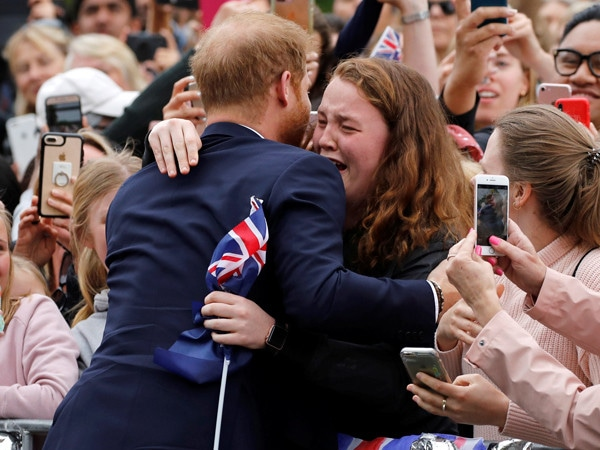 Aw! Prince Harry Brings a Fan to Tears With a Sweet Hug on the Royal Tour