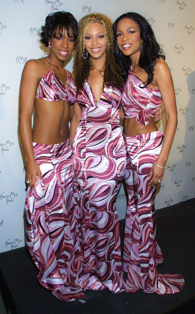 Destiny's Child -  The iconic girl group was known for their matching outfits and these pink swirl-patterned looks from the 2001 awards are looks to remember.