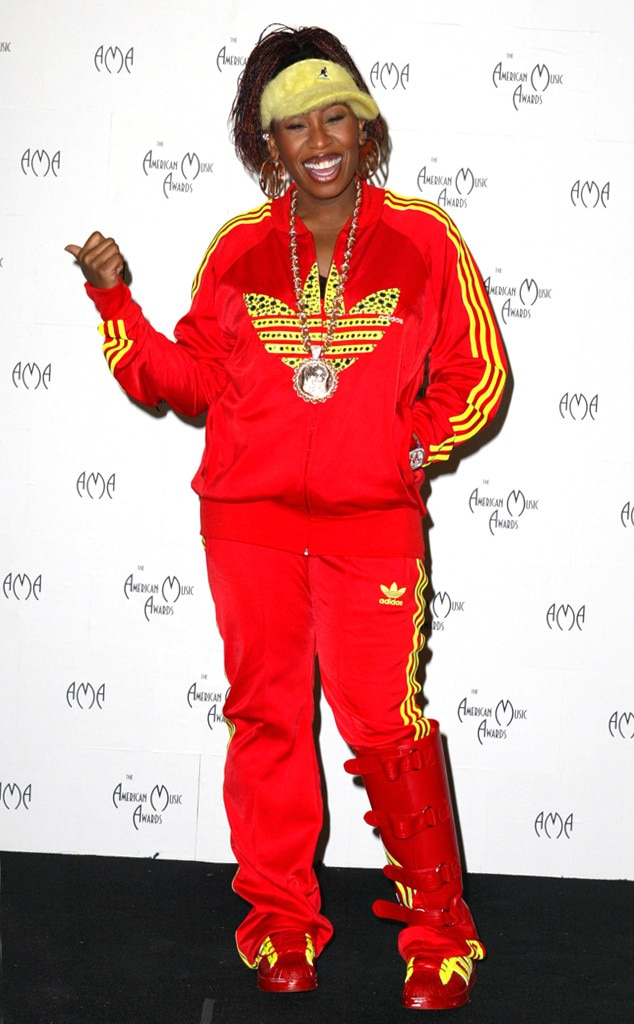 Missy Elliott -  Matching head to toe, Missy Elliott rocked a red and yellow bedazzled Adidas sweat suit to the 2003 AMAs.