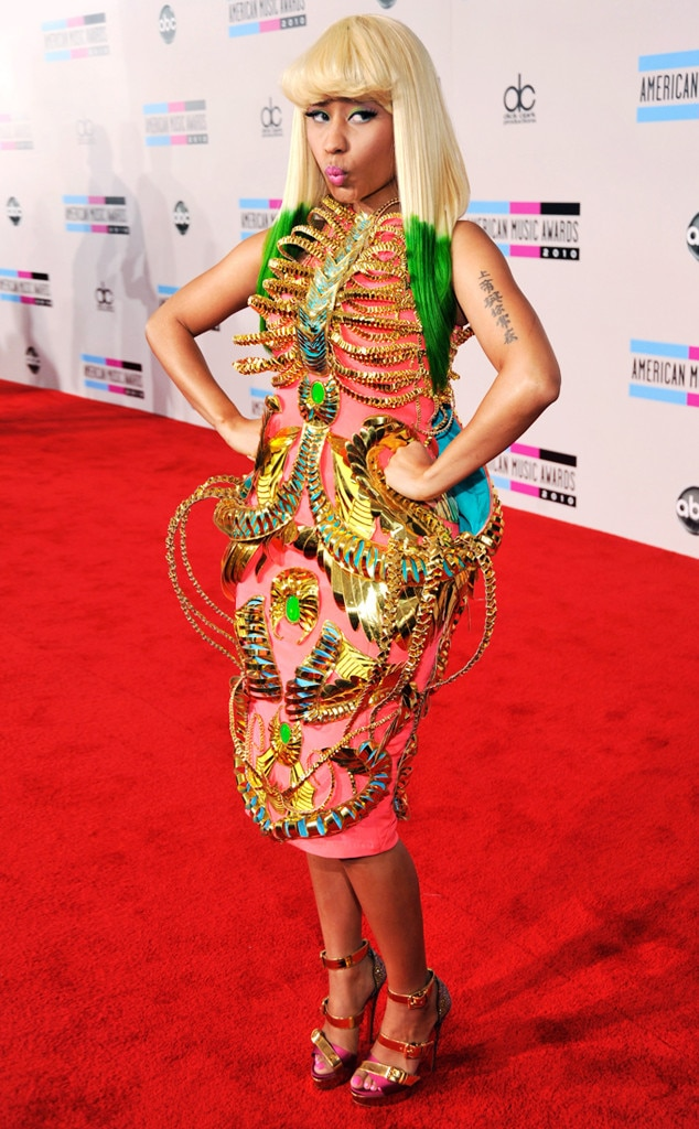 Nicki Minaj -  This 2010 AMA look is one of Nicki's wildest to date! The coral-colored dress features an extravagant gold skeleton-style structure including a ribcage design.