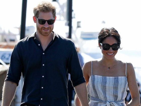Meghan Markle Cradles Her Baby Bump on a Stroll With Prince Harry