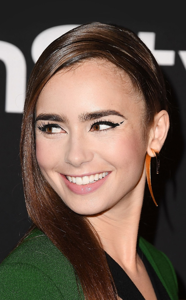 Lily Collins -  Lilly redefined cool-girl makeup with this upgraded graphic cat eyeliner look.