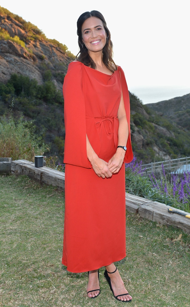 Royal in Red -  The actress celebrated her collaboration with Fossil in this stunning red Rosie Assoulin cape dress paired with a black watch from her collection and matching black strappy heels.