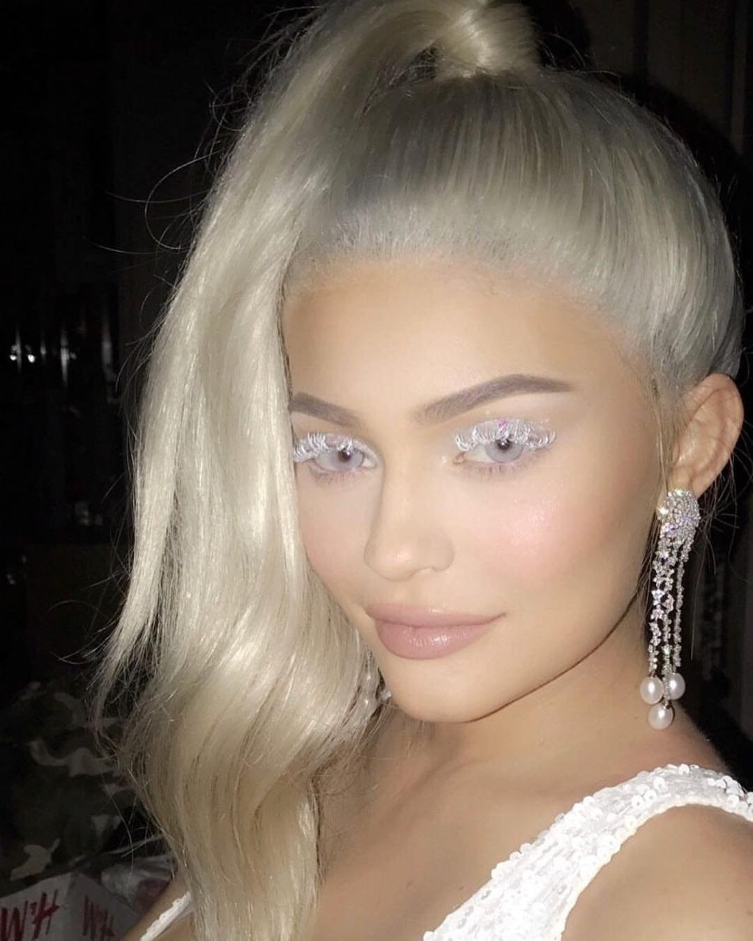 """Ice Queen -  With bestie Jordyn Woods  by her side in a fire-inspired costume, Kylie resembles """"ice"""" with a platinum blonde ponytail and eyelashes to match during Halloween 2017."""