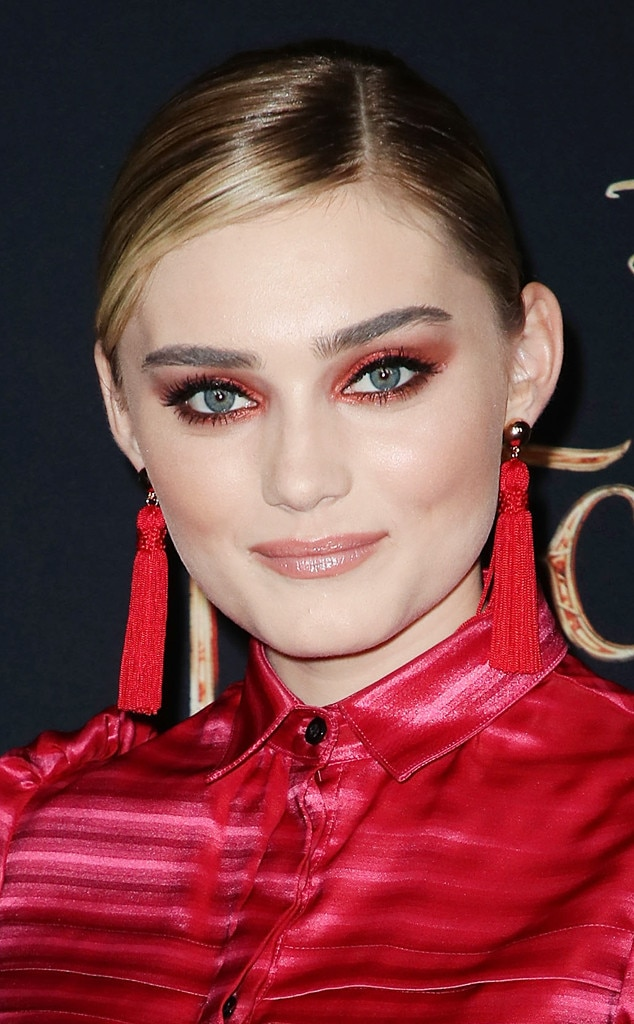 Meg Donnelly -  The actress and singer matched her silk red dress with vibrant red eye shadow and a slicked-back ponytail.