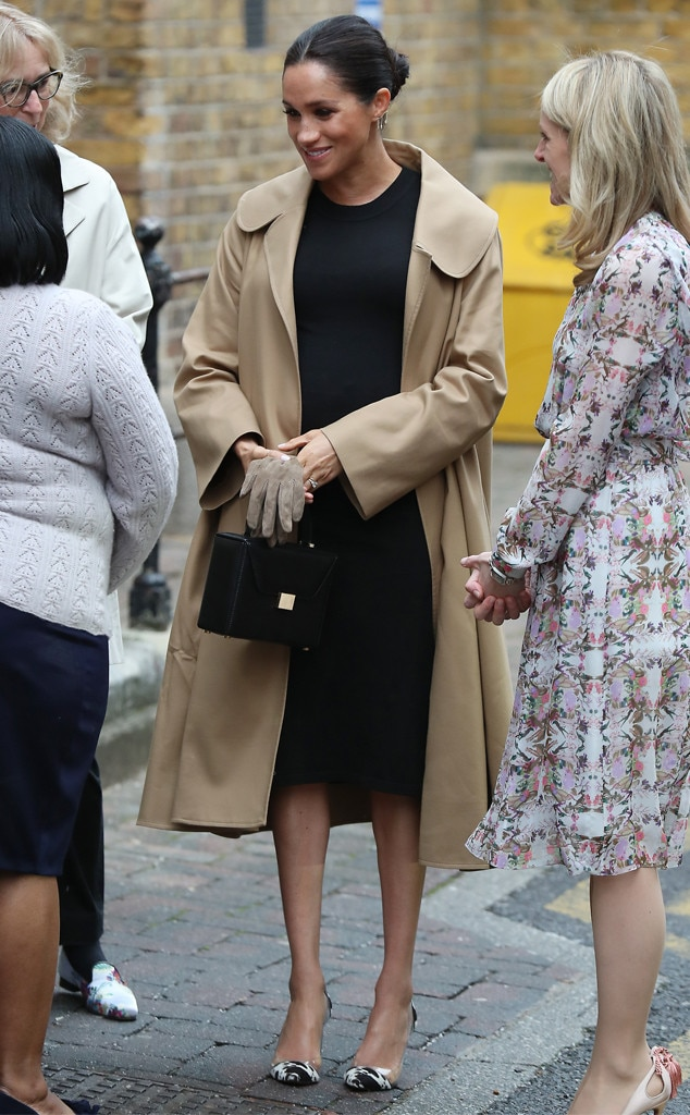 Cozy and Cute -  During her first engagement of 2019, Meghan wore a sleek, black dress from HATCH Collection, which she paired with a Victoria Beckham box bag. The show-stopper was her Oscar de la Renta trench coat.