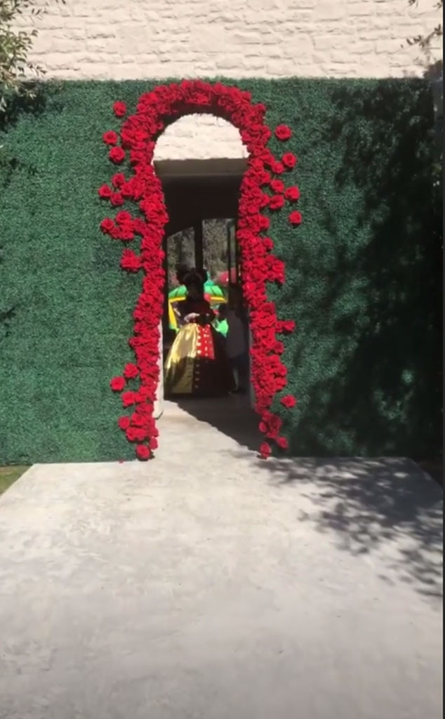 Down the rabbit hole -  Kim Kardashian had a keyhole-shaped entrance to the grand party.