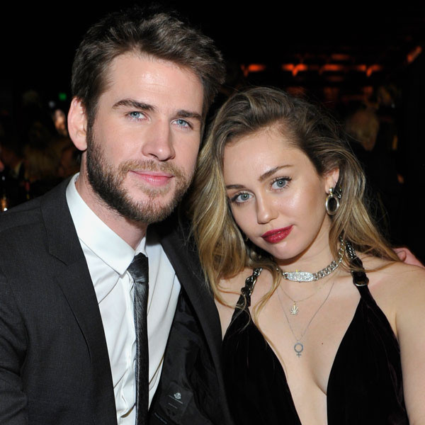 Here's the Real Reason Liam Hemsworth Didn't Attend the Grammys With Miley Cyrus
