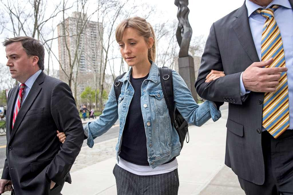 Allison Mack -  Theformer Smallville star, who playedreporter Chloe Sullivan for 10 seasons, has pleaded guilty toracketeering conspiracy and racketeering acts of state law extortion and forced labor. She was originally charged withsex trafficking, sex trafficking conspiracy and forced labor conspiracy, like Raniere.