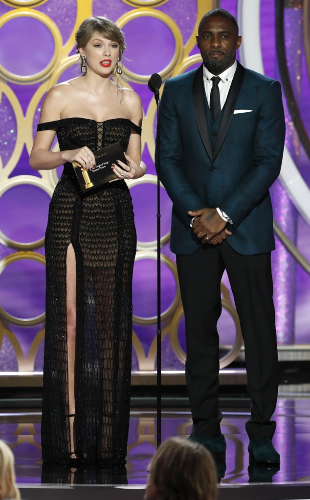 Surprise -  Look who's here! Alongside  Idris Elba ,  Taylor Swift  made a surprise appearance to present two very special awards at the 2019 Golden Globes