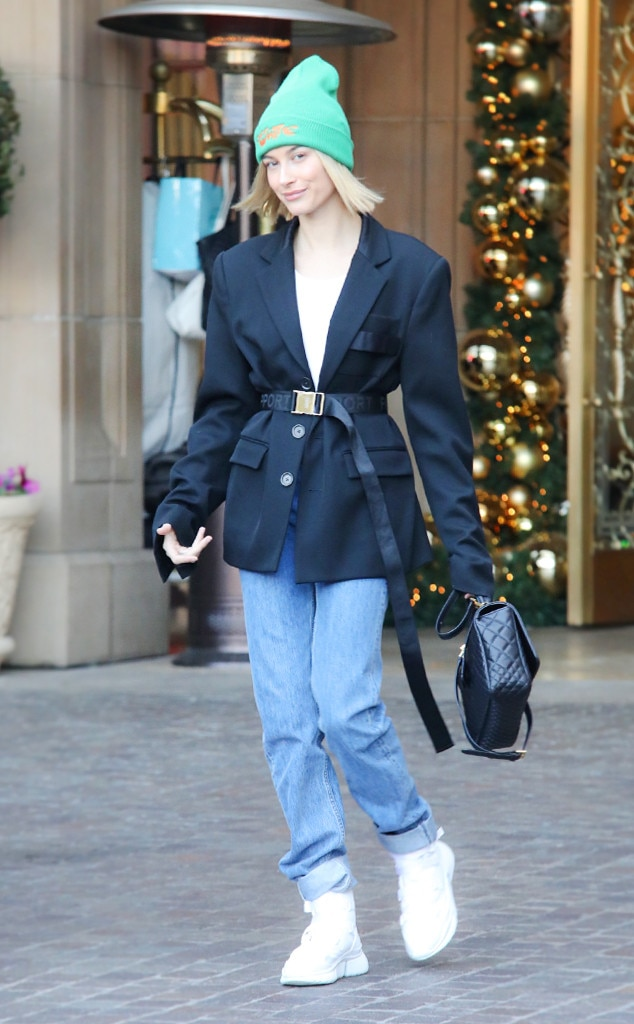 #WorkFlow -  Hailey flashed a smile whilesporting one of this year's hottest trends—a green beanie!