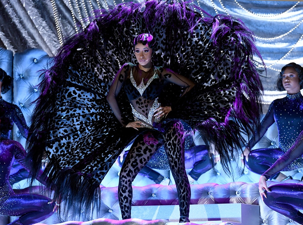 Fierce and Fabulous -  Not surprisingly, Belcalis Almanzar drops jaws during her 2019 Grammys performance. She rocks a 1995 archive Thierry Mugler bodysuit, which comes with larger-than-life feathers.