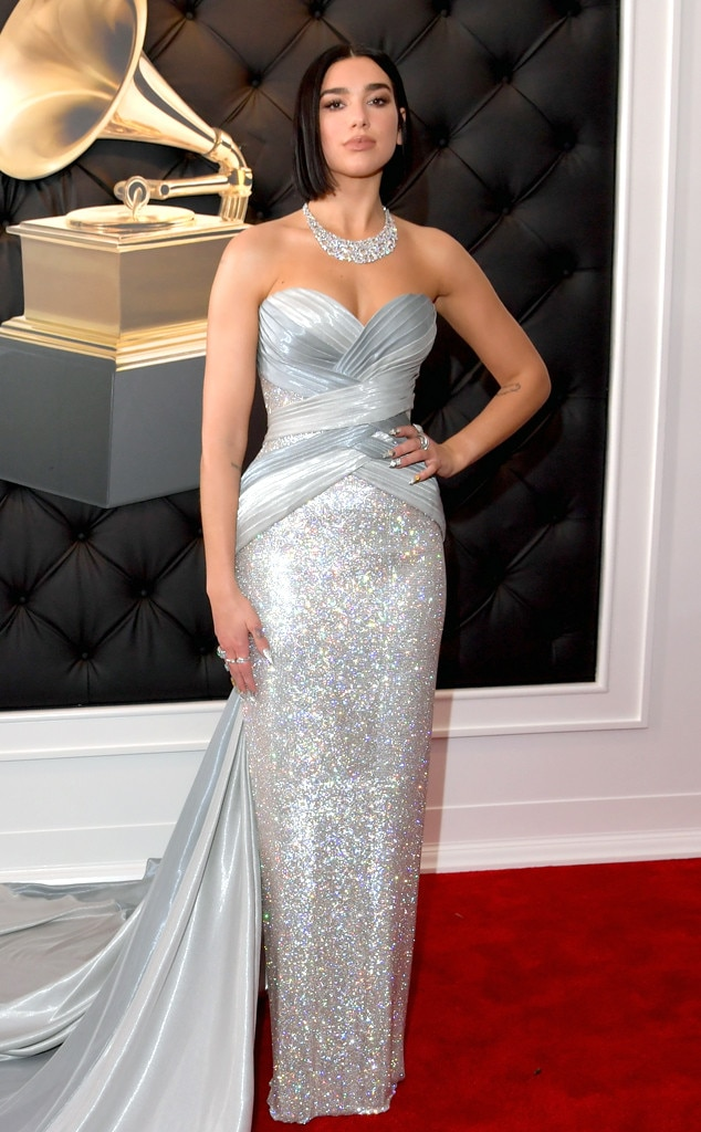 Dua Lipa -  The first-time Grammy winner shinned in a silver, sequinned gown.