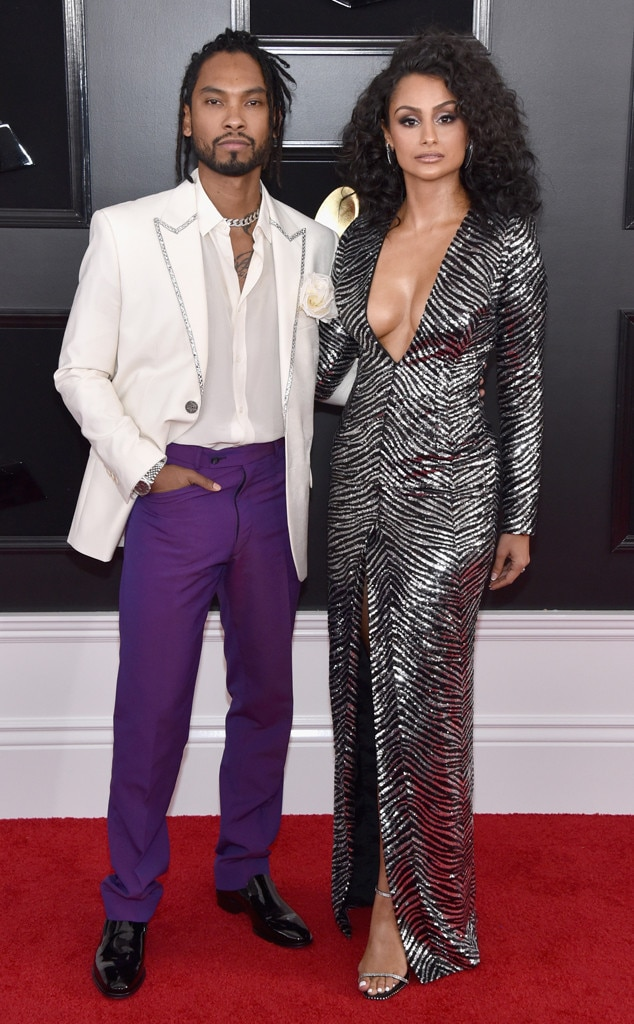 Miguel & Nazanin Mandi -  The newlyweds maintain stoic expression while posing at the Grammys.