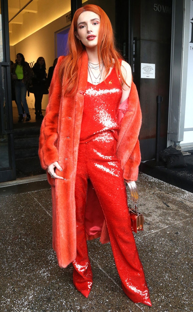 Fire Red -  Actress  Bella Thorne  is blazing in a hot red sequin jumper, paired with a fuzzy bright coatat the Sally La Pointe show during New York Fashion Week.
