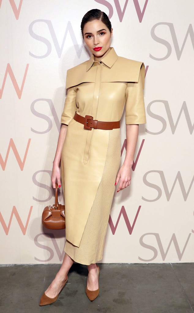 Runway Ready - Olivia Culpo  looks flawless at the Stuart Weitzman Spring Celebration in New York, wearing a structured leather dress, brown suede pumps, and a Gabriela Hearst leather tote.
