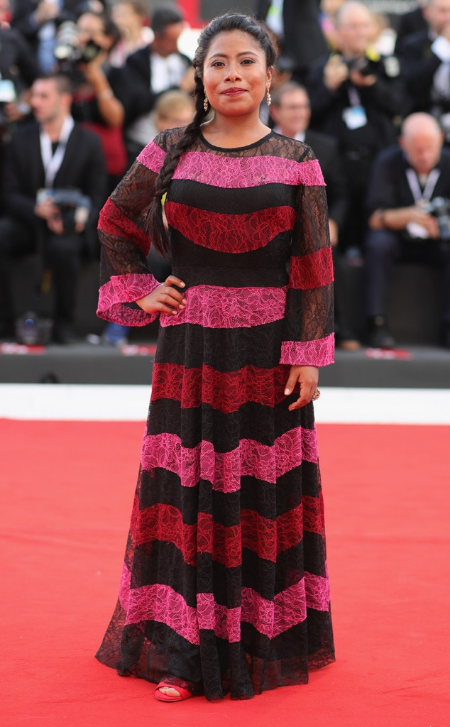Roses Are Red -  The 25-year-old beauty attends the 75th Venice Film Festival in a gorgeous multi-colored, long-sleeve gown.