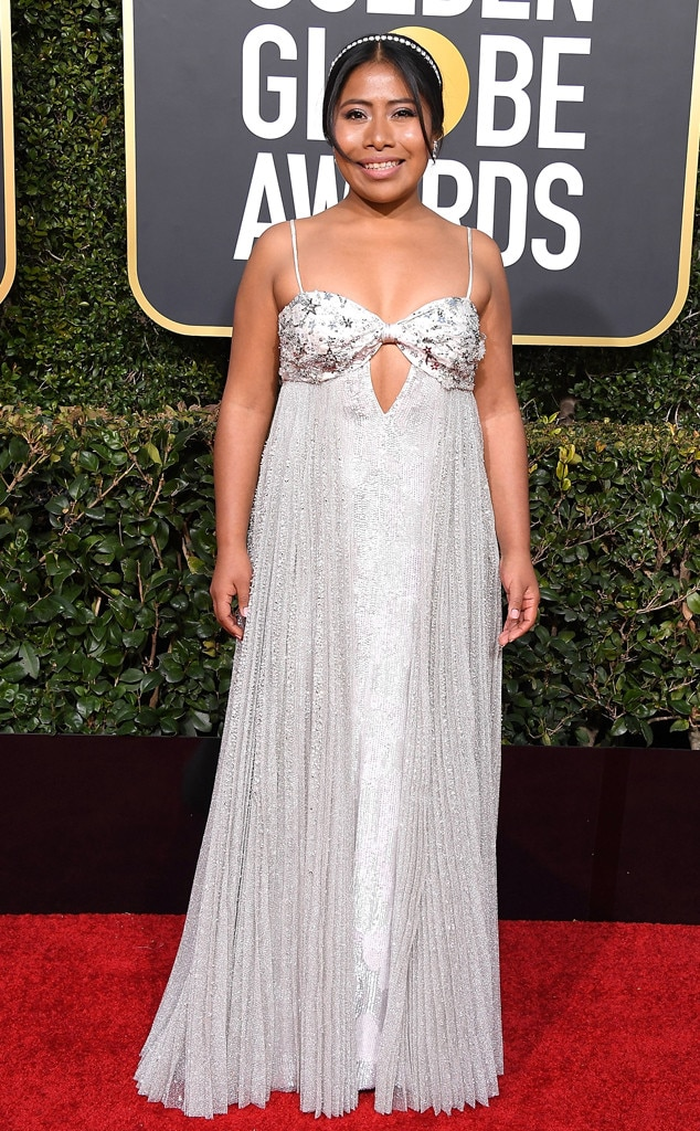 Silver Sparkler -  Looking like a modern-day Cinderella, Yalitza attends the 2019 Golden Globe Awards in a lustrous silver lamé gown by Miu Miu. If you look closely, the dress has star embellishments and sequins.