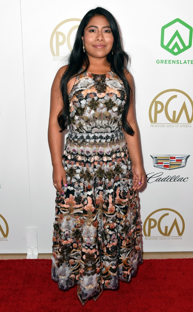 Bold Prints -  Yalitza is not only turning heads with her breakout role in  Roma , but she's keeping fans on their toes with her daring fashion. At the Producers Guild Awards, the actress opts for something unique with her bold-printed Dior dress.