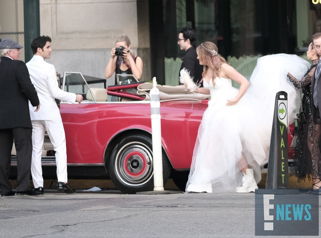 Keeping it comfortable -  The new Mrs. Criss showed off her shoe choice before getting into the convertible.