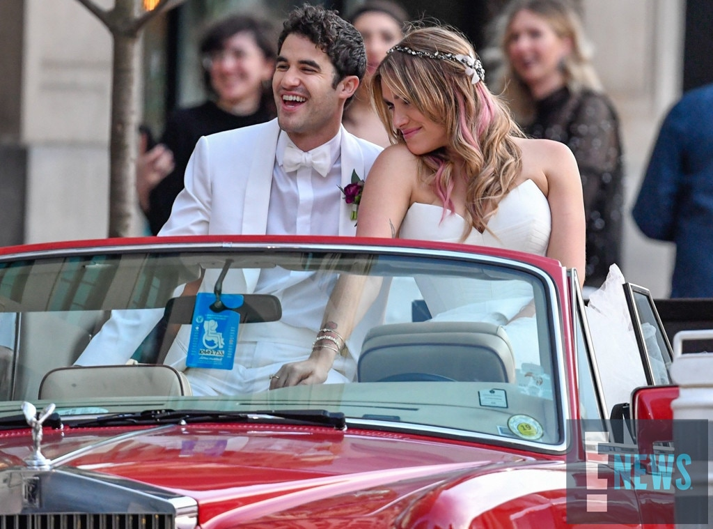 Riding into marriage -  Mia and Darren rolled off in a red Rolls Royce convertible and looked super happy doing so.