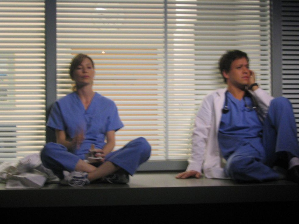 Ellen Pompeo and T.R. Knight -  This is a behind-the-scenes photo of a classic scene between Mer and George.