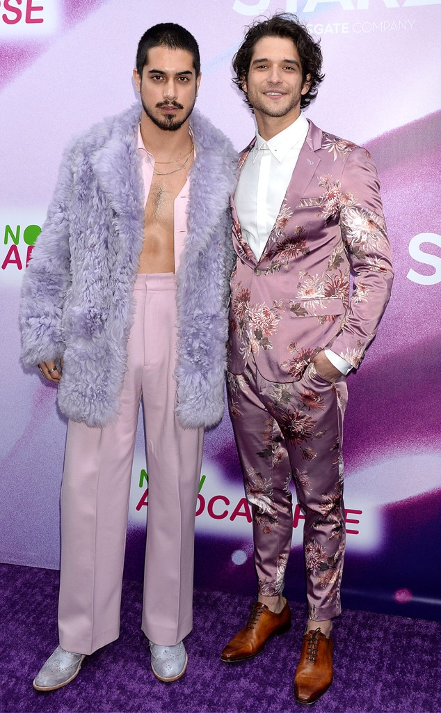 Double Trouble - Now Apocalypse  co-stars  Avan Jogia  and  Tyler Posey  get playful with mauve tones at the show's premiere in L.A. with Jogia in a fur-coated look by Sies Marjan, and Posey in a floral suit.