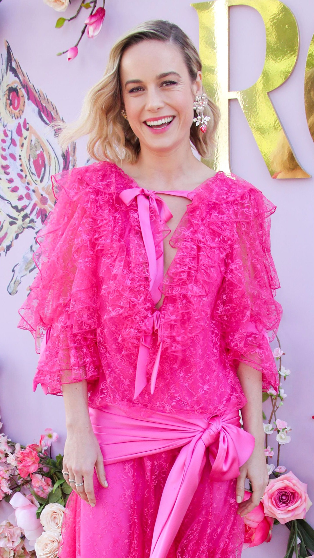 Giving Joy -  While attending the Rodarte show at Los Angeles Fashion Week, Brie looked pretty in pink thanks to her dress.