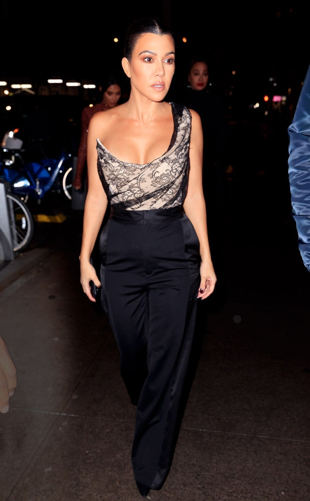 Corset Craze -  Kourtney sizzles in a Vivienne Westwood corset top from Pechuga Vintage. It features a sultry black lace overlay and asymmetric design.