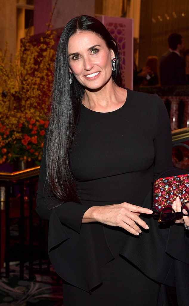 Demi Moore -  The actress smiled in a black design.