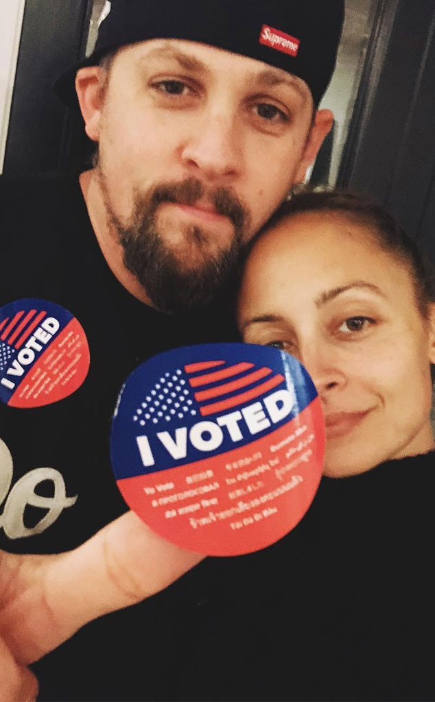 """Rock the vote -  The parents of 2 show off their """"I Voted"""" stickers."""