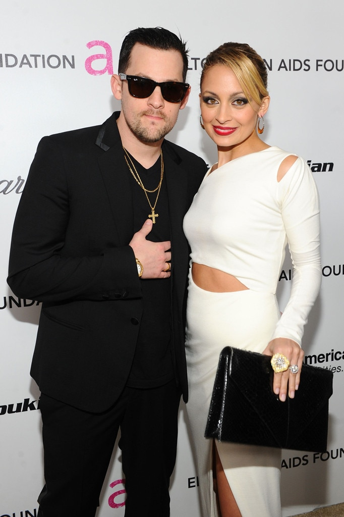 White hot -  The Good Charlotte singer dons an all-black suit while she opts for a white outfit at Elton John's AIDS Foundation Academy Awards Party in 2011. Nicole's large engagement ring was on full display, too.