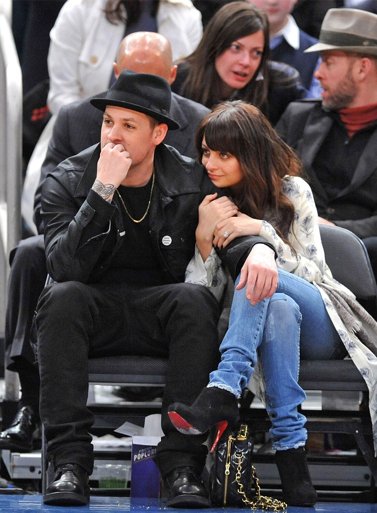 Slam dunk for love -  The two of them snuggle up at a New York Knicks basketball game in 2010.