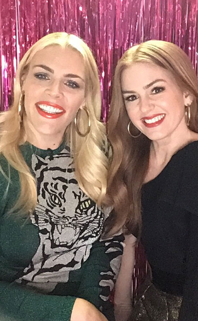Isla Fisher - The Beach Bum  actress looks picture perfect next to Busy in the photo booth.