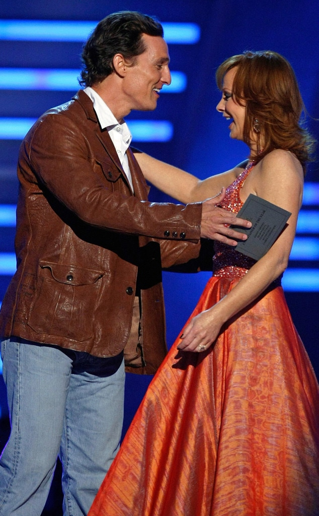 Matthew McConaughey & Reba McEntire -  You never know who will will show up for this Las Vegas party. The  Dallas Buyers Club actor shares a moment with the country icon while on stage.
