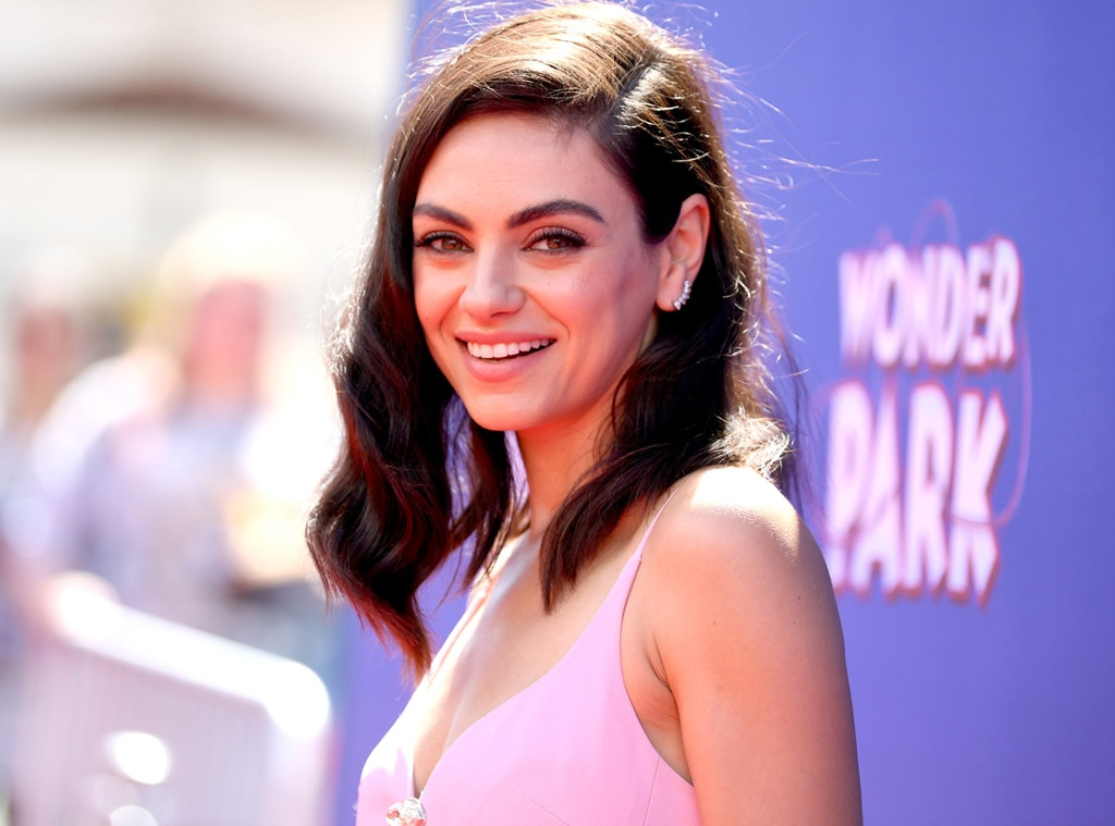 Mila Kunis -  The actress gives a smile during the premiere of Wonder Park.