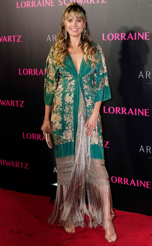 Springin In -  Model  Heidi Klum  is looking festive for spring a green floral robe and fringe metallic dress at The Jewelry of Lorraine Schwartz event in Hong Kong.