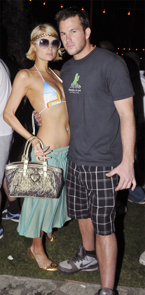 Paris Hilton & Doug Reinhardt -  Paris Hilton keep it relatively simple in a bikini top and long green skirt. Her large gold bag matches her shoes and headband (a Coachella must).