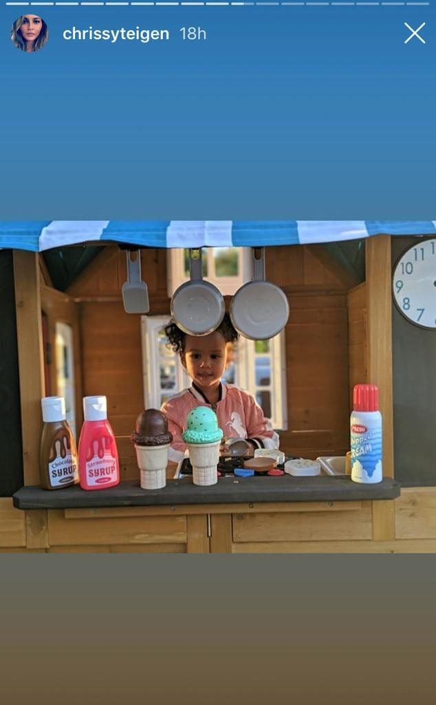 It's Play Time -  Chrissy Teigen documented Luna's time in the backyard where she had some fun in her own KidKraft seaside cottage  playhouse .