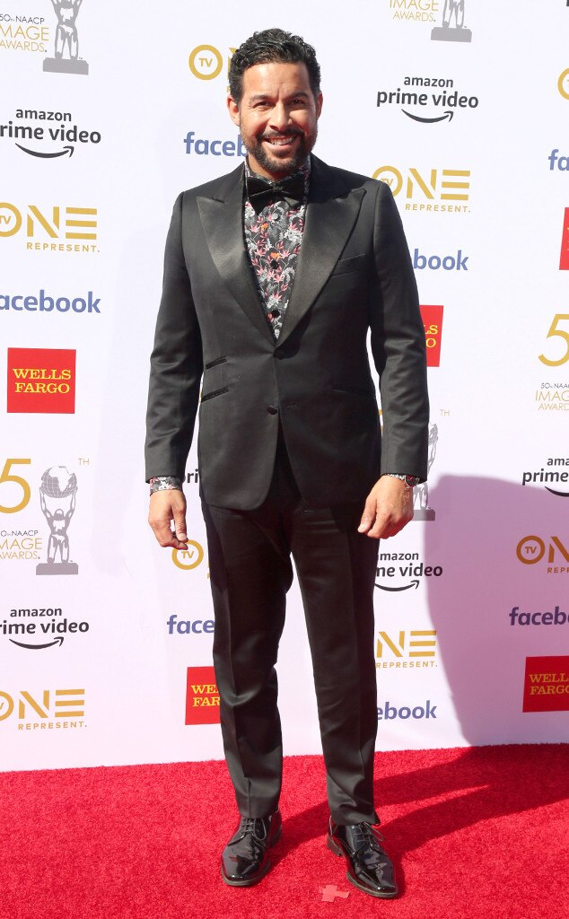 Jon Huertas -  Jon Huertas balances his black tux with a colorful shirt at the awards show.
