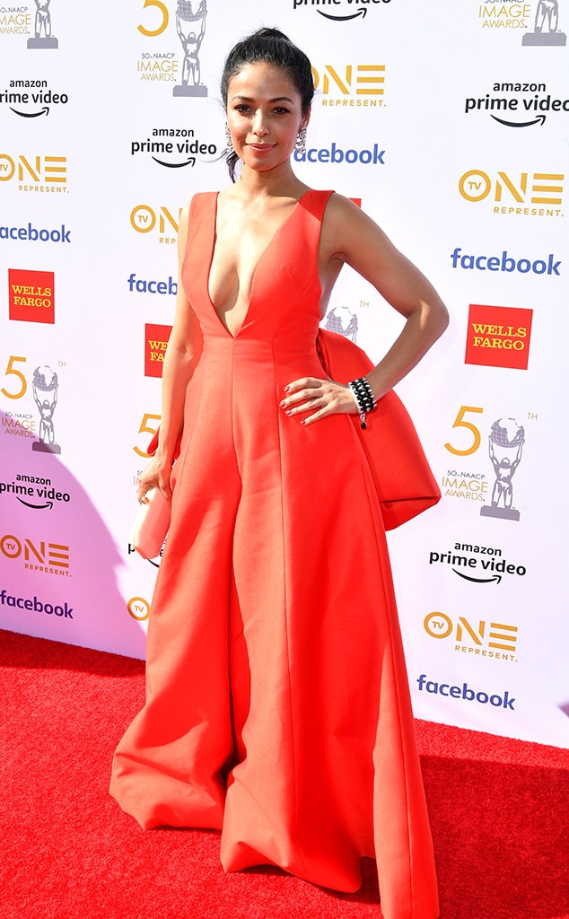 Meta Golding -  The  Empire  star matches the carpet in a gorgeous red get-up.