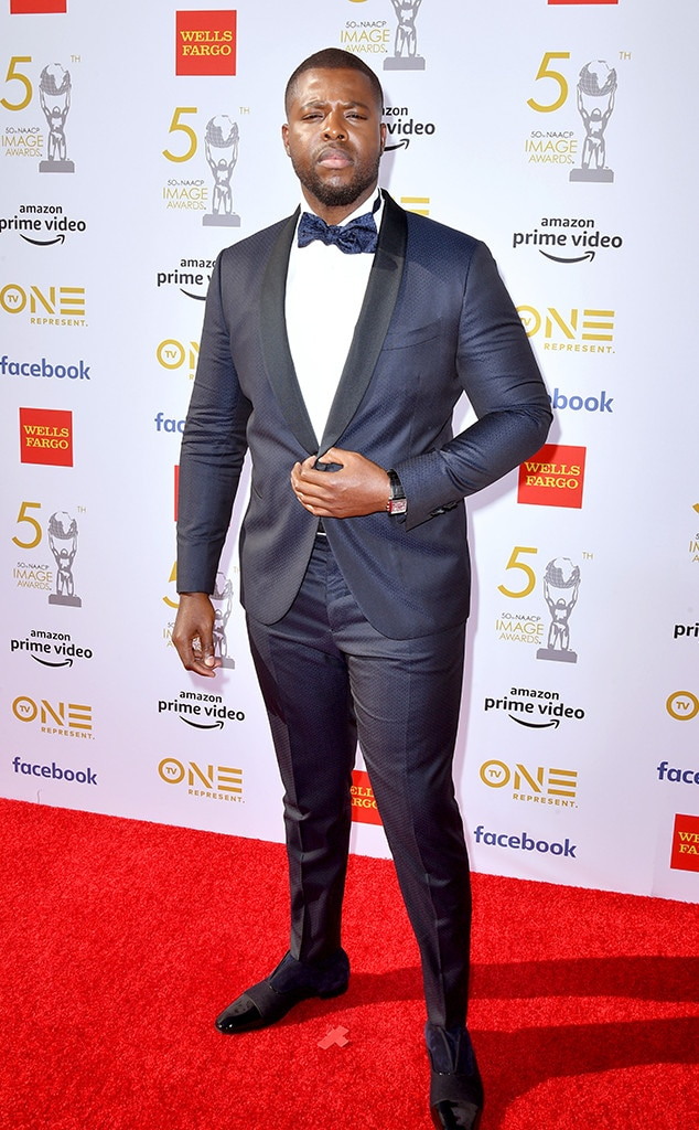 Winston Duke -  The  Us  star poses in a two-tone tuxedo at the show.