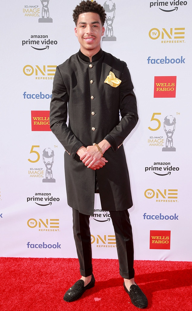 Marcus Scribner -  The black-ish  actor keeps it cool in a black jacket and black loafers with a yellow pocket square.