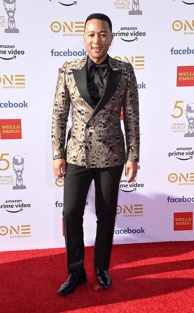 "John Legend -  The ""All of Me"" singer arrives looking stylish at the NAACP Image Awards."
