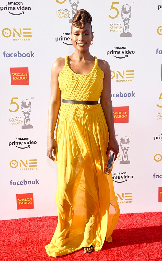 Issa Rae -  The  Insecure  star shines in yellow on the carpet.