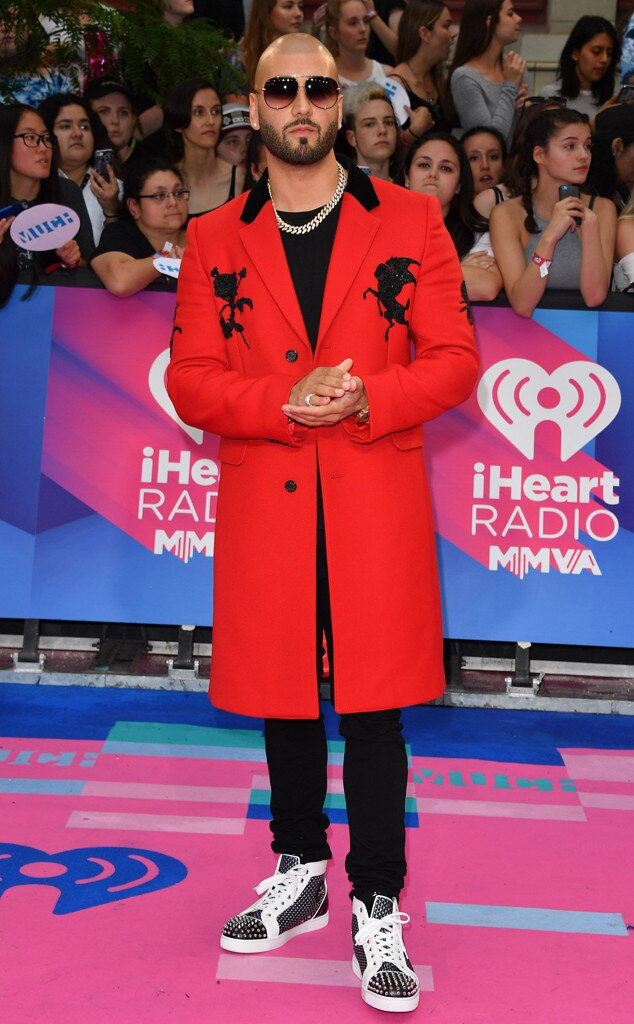 Massari -  Skipping the usual black and white tux, Massari opts for an ostentatious ensemble. He pairs his red embroidered coat with flashy shoes and jewelry pieces.