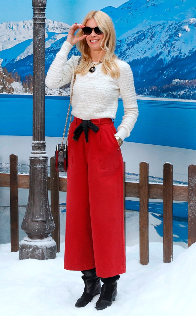 Claudia Schiffer -  The supermodel brought a pop of color to the show in red pants.