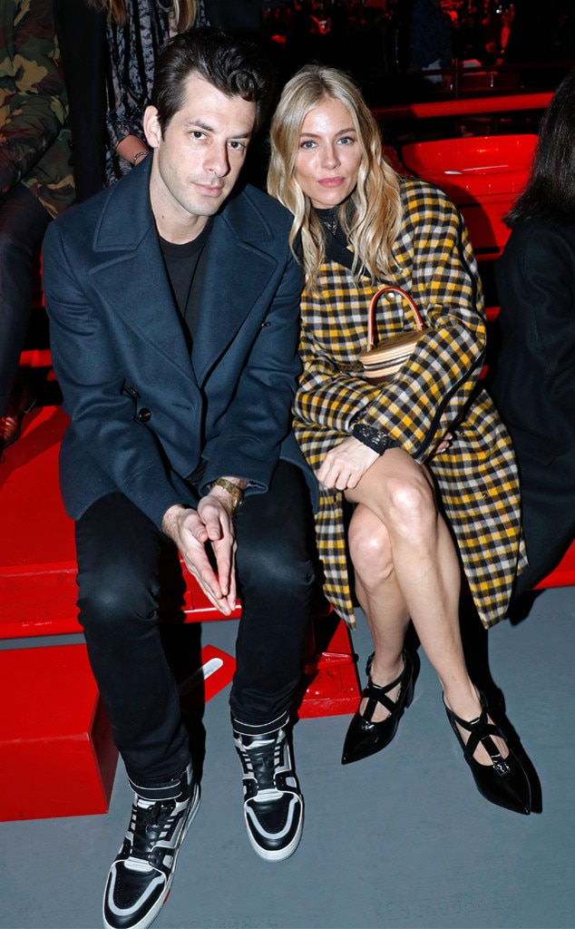 Mark Ronson & Sienna Miller -  Front row friends! Thefamous Britsget comfortable as they wait to watch the Louis Vuitton show during Paris Fashion Week.